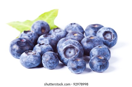 many of blueberries with leaf on white