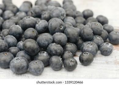 many blueberries lying on wood