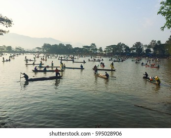 Many boats in lake for fishing.