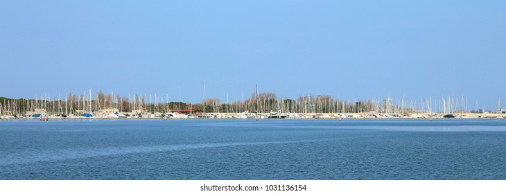 many boats and yachts moored at touristic port