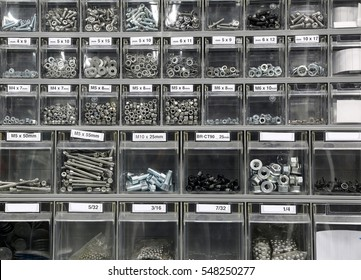 Many bolts and steel washers and iron in hardware store