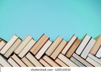 Many Books Piles. Hardback books on wooden table. Back to school. Copy space