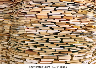 Many books stacked on top of each other.