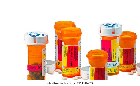 Many bottles of medicine with child proof caps to show danger of high health cost.