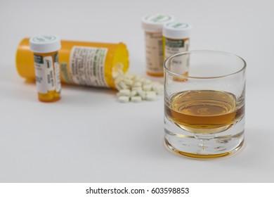 Many Bottles of Pharmaceutical pills spilt and alcohol