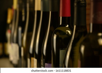 many bottles of wine stand in a row in the cellar - Shutterstock ID 1611118831