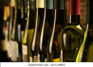 many bottles of wine stand in a row in the cellar - Shutterstock ID 1611118852