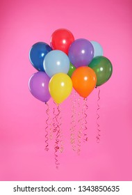 Many bright balloons floating on color background