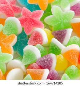 Many bright color jelly candies, sweets with sugar tasty as jujube and lollipops.