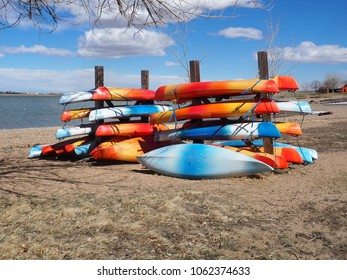 Many bright colored kayaks in storage during the off-season.