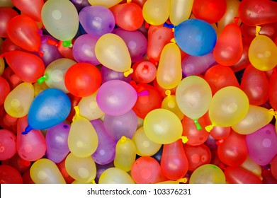 Many bright and colorful water balloons