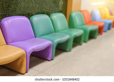 Many brightly colored chairs for children, space for text.