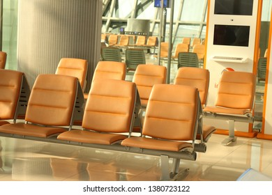 many brown chair in the airport