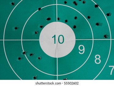 Many bullet holes in the target and intact bulls-eye - inaccuracy concept