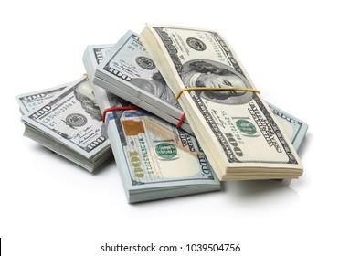 Many bundle of US 100 dollars bank notes isolated on white background