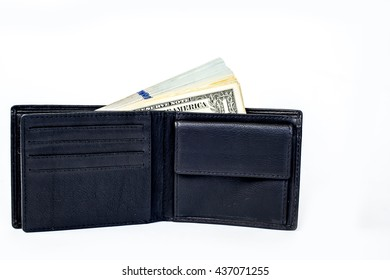 Many bundle of US dollars bank notes in black wallet isolated on white