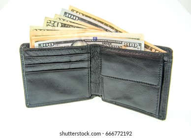 Many bundle of US dollars bank notes in black wallet  on white background