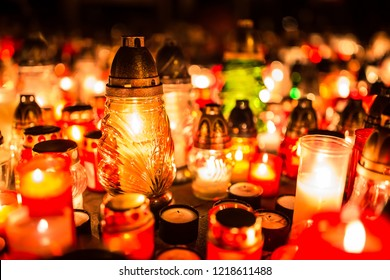 Many burning candles in the cemetery at night on the occasion souls of the deceased.