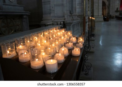 Many burning candles at a church background