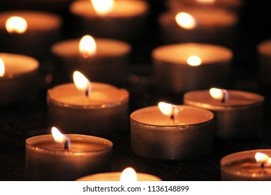 many burning candles in metal containers for soothing or relaxing