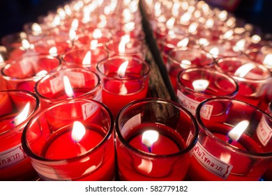 Many burning candles with shallow depth of field. Selective focus