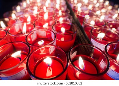 Many burning candles with shallow depth of field. Selective focu