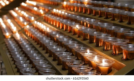 Many burning candles with shallow depth of field.