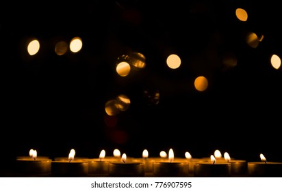 Many burning candles with shallow depth of field. Blurred lights. Christmas time. Christmas day. Fashion photo. Background.