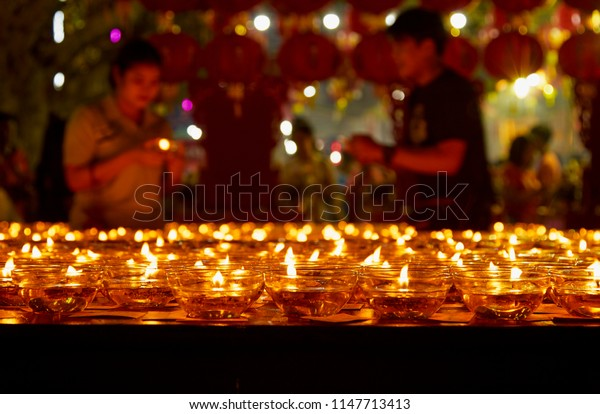 Many burning candles with shallow depth of field, Candles in a church