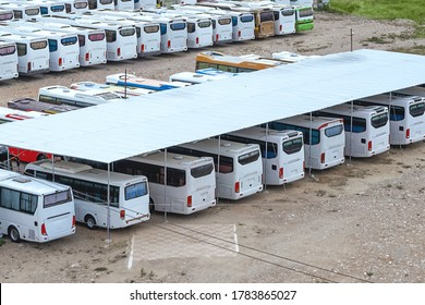 Many buses in the open parking.  Lack of demand for public transport during quarantine.