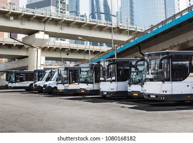 many buses in the Parking lot in the city center