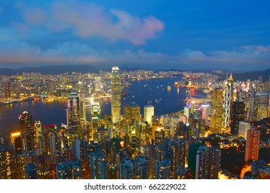 many business financial buildings at the bay of Hong Kong at dusk