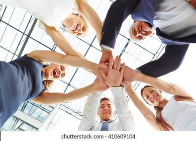 Many business people stacking their hands as concept for teamwork
