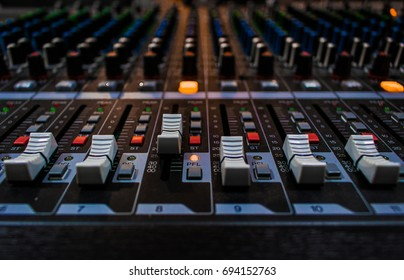 Many Buttons of audio mixer board console