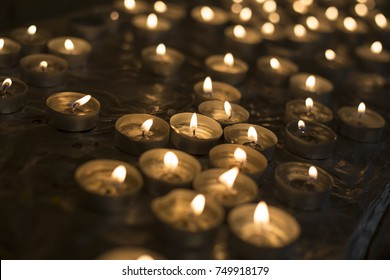 Many candles burn in the church