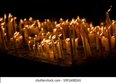 Many candles in a religious temple