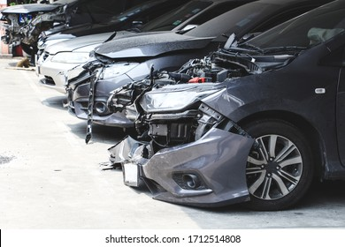 Many Car wreck in the parking with crash big damaged and broken . Car accident and safety concept.