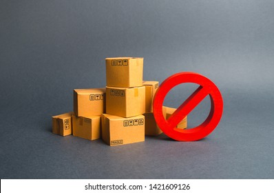 Many cardboard boxes and a red symbol NO. Embargo, trade wars. Restriction on the importation of goods, proprietary for business. Inability to sell products, ban on the import. No delivery.