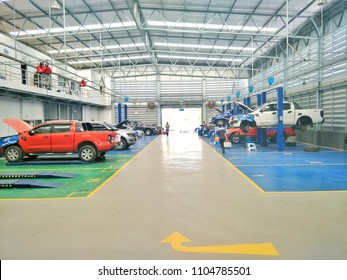 Many cars are being serviced in large service centers with standard car inspection and repair.June 4,2018 : Chiang Mai,Thailand.