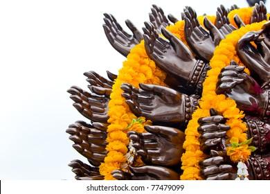 Many cast bronze hands of god Ganesha with yellow garland,Wat Samarn,Chacheangsoa,Thailand.