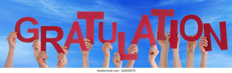 Many Caucasian People And Hands Holding Red Letters Or Characters Building The German Word Gratulation Which Means Congratulation On Blue Sky