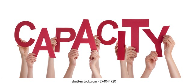 Many Caucasian People And Hands Holding Red Letters Or Characters Building The Isolated English Word Capacity On White Background