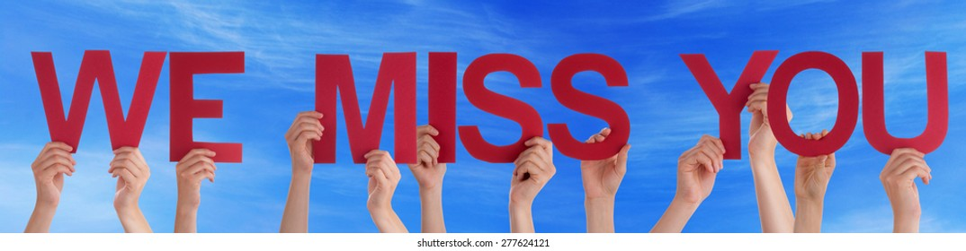 Many Caucasian People And Hands Holding Red Straight Letters Or Characters Building The English Word We Miss You On Blue Sky