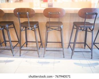 many chairs arrange with wood bar in coffee shop