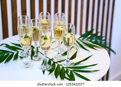 Many champagne glasses on the presentation table
