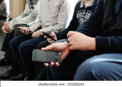 many children are holding a mobile phone and play games. dependence on the smartphone. samartfon, play, modern, young, childhood, disease