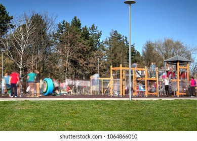 Many children and young people moving in the park to play