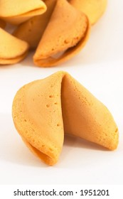 Many Chinese fortune cookie one stand out, on white background, closeup