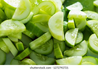 Many chopped cucumber for salad and cooking food, this Fresh Cucumber for mass street food vendor prepare for ready meal, background shadow selective focus