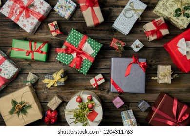 Many Christmas or birthday gifts presents box in vertical top view vintage wood.Gift present boxes decorated frame.Xmas winter holiday season festive social media card background